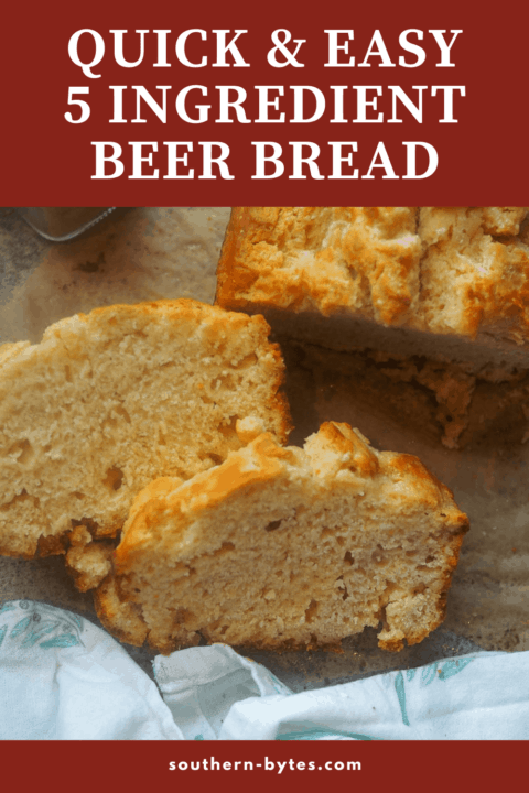 A pin image two slices of beer bread on parchment next to the rest of the loaf.