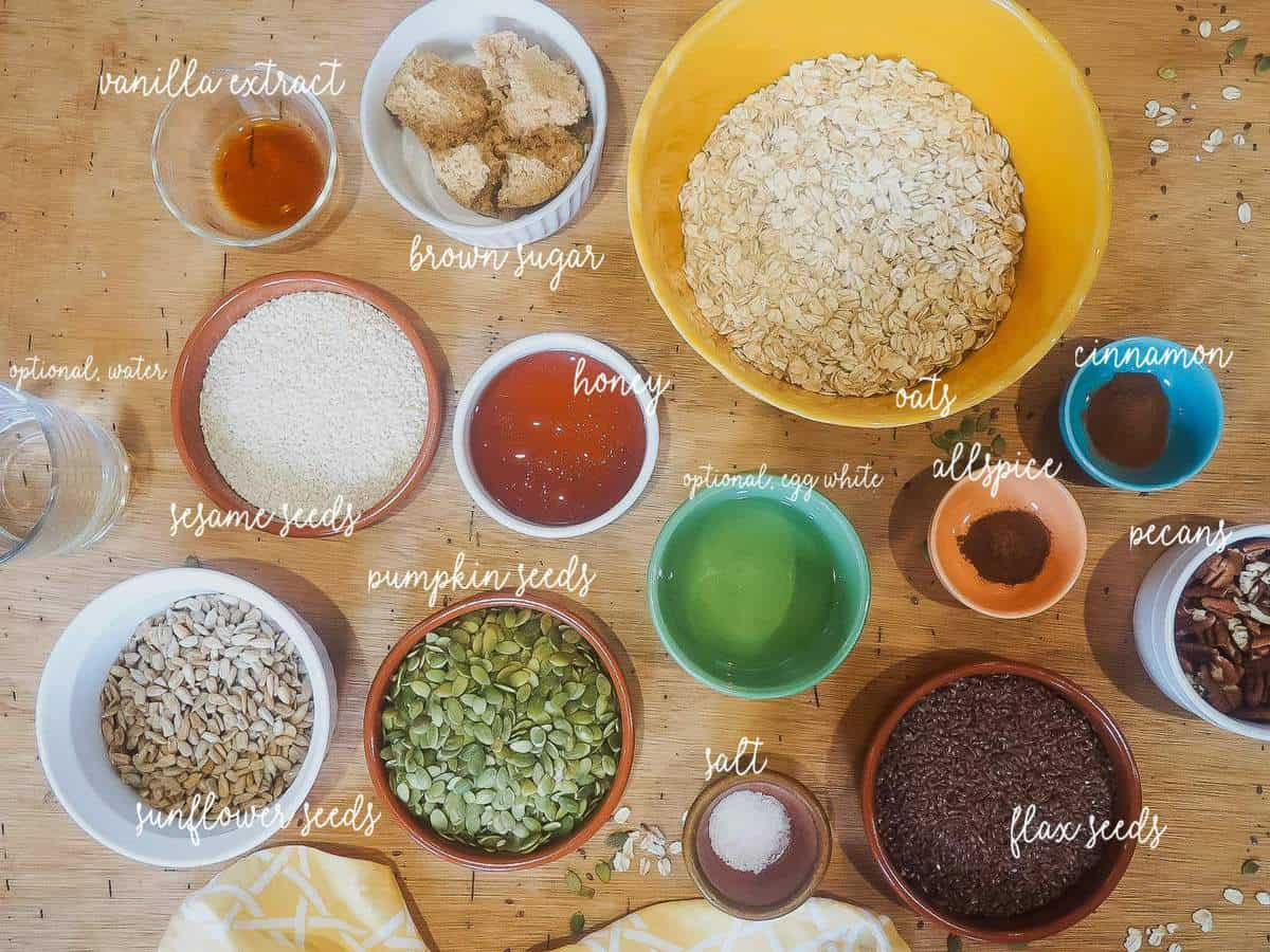 A picture of the ingredients in homemade granola, laid out and labeled.