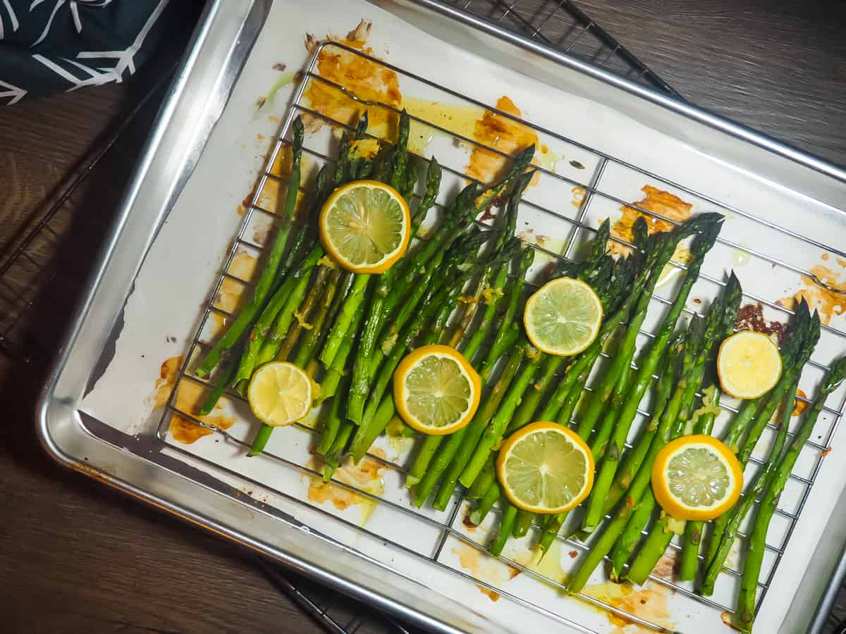 Cooked lemon asparagus on a cooling rack.