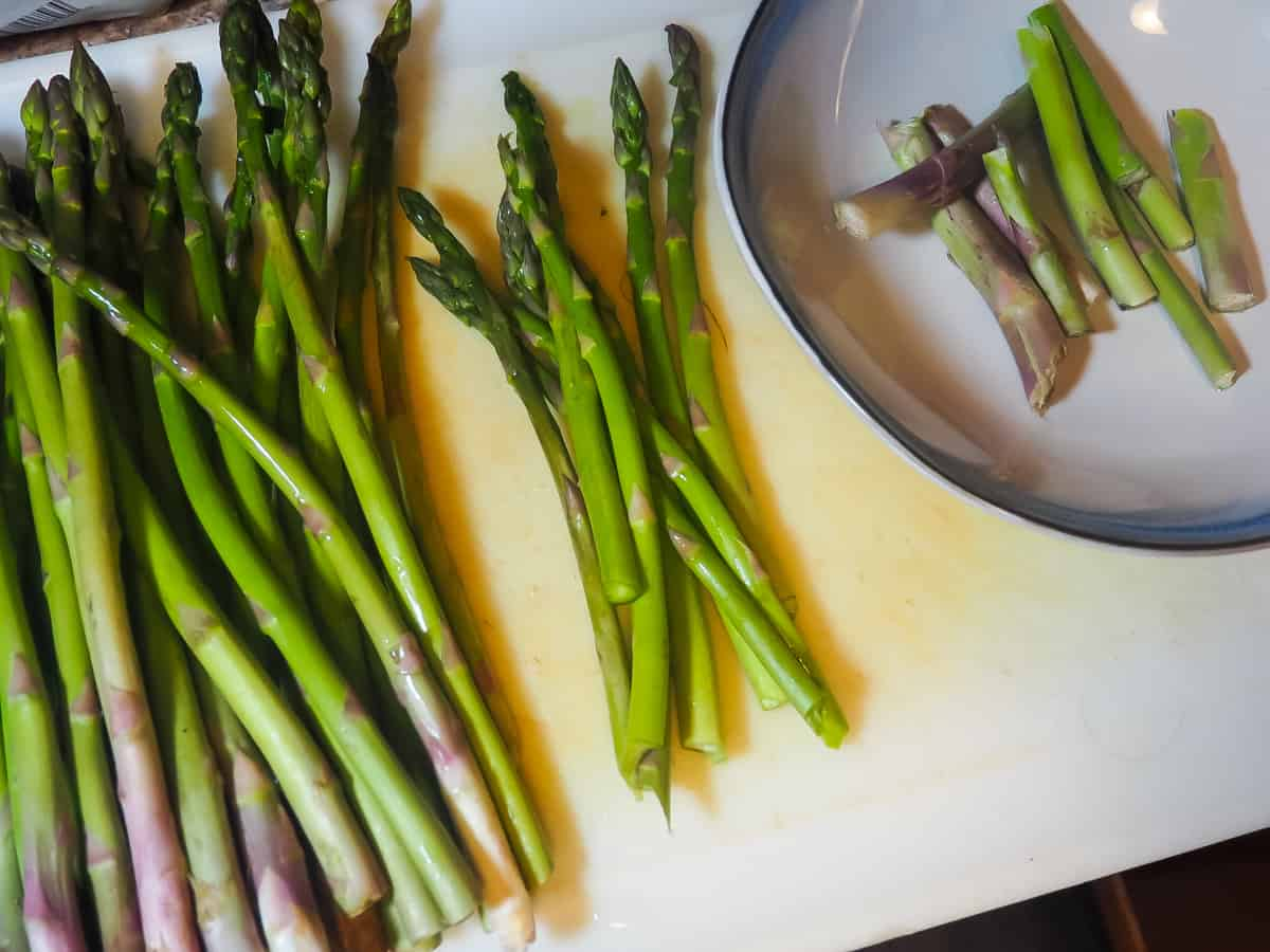 Asparagus being snapped at the bottom.
