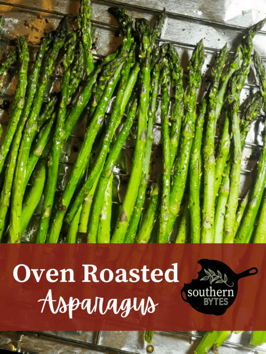 A picture of roasted asparagus on a tray.