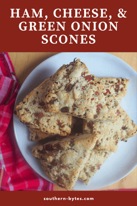 A pin image of a white plate of ham and cheese scones.