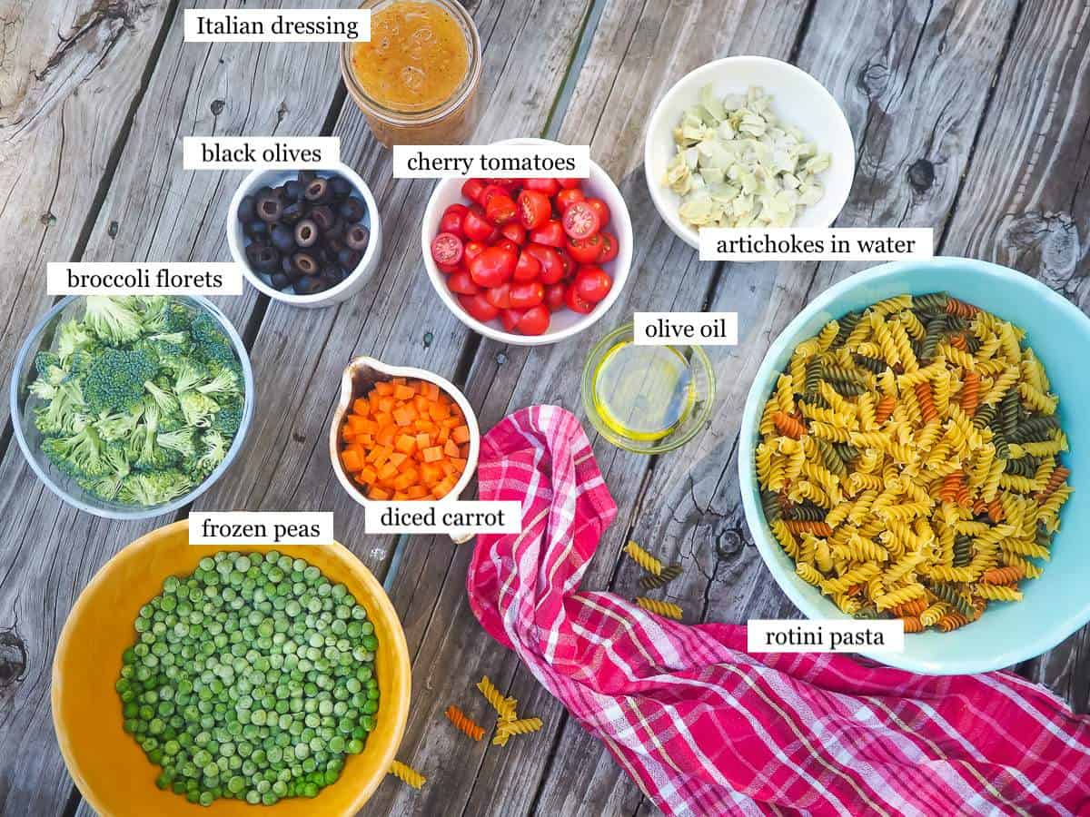 The ingredients in pasta salad, laid out and labeled.