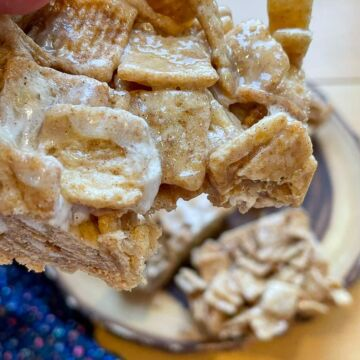 A Cinnamon Toast Crunch Cereal Treat with a bite taken out.