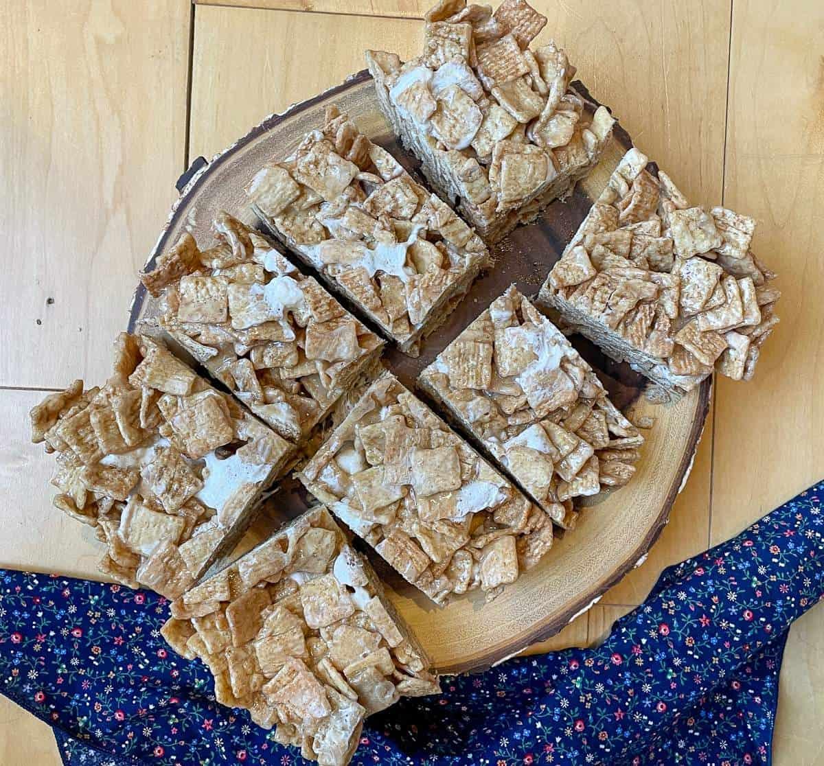 Cinnamon Toast Crunch Cereal Treats on a wood board.