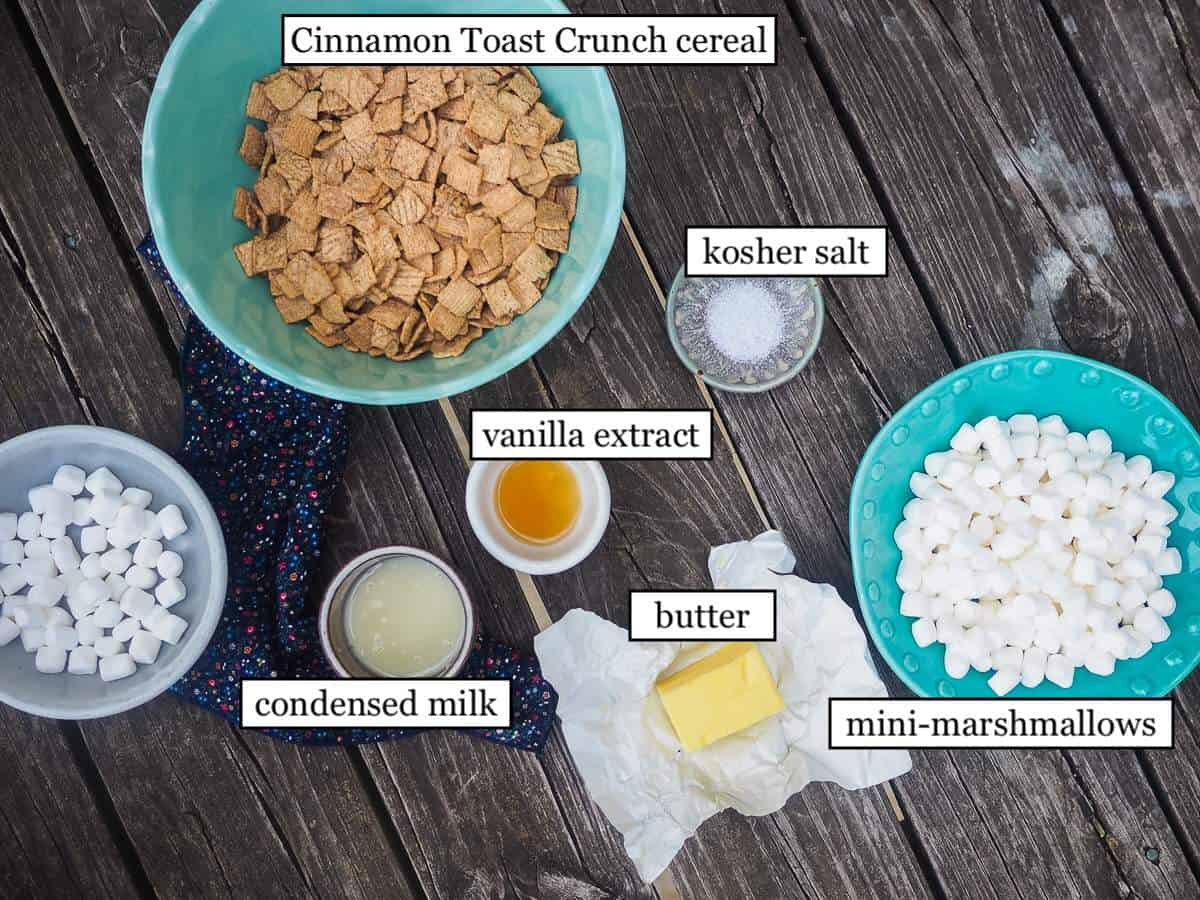The ingredients in Cinnamon Toast Crunch Cereal Treats laid out and labeled.