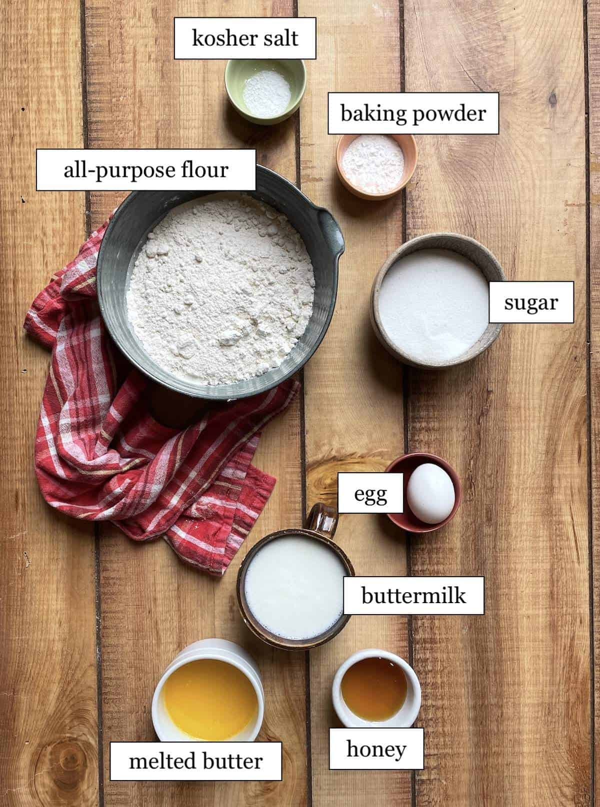 The ingredients in buttermilk muffins laid out in bowls and labeled.