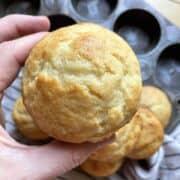 A hand holding a buttermilk muffin.