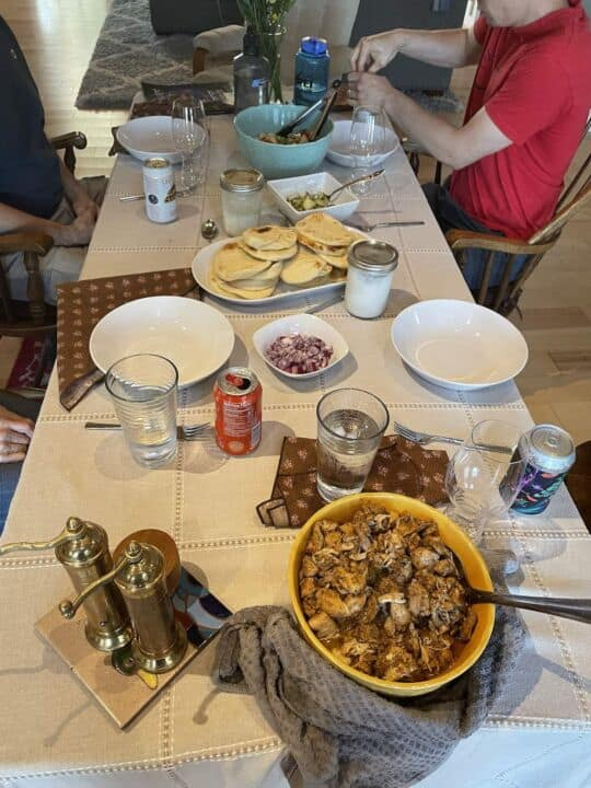 a table spread with chicken shawarma on it