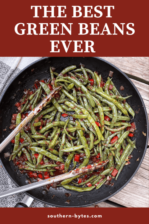 A pin image of a frying pan filled with green beans and a pair of tongs.